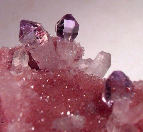 lavender-tipped pink gemstone. a chunk of raw, sweet, sparkling, semiprecious sugar.
