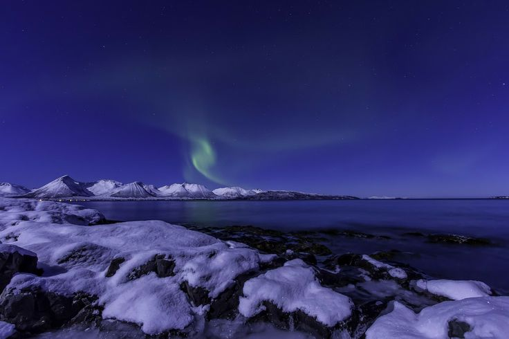 Small amount of aurora by Robert Alexandersen on 500px