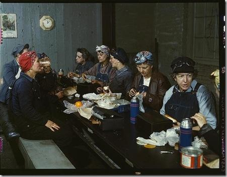 Women workers employed as wipers in the roundhouse having lunch in their rest room, Chicago and Northwest Railway Company. Clinton, Iowa, April 1943. Reproduction from color slide. Photo by Jack Delano. Prints and Photographs Division, Library of Congress