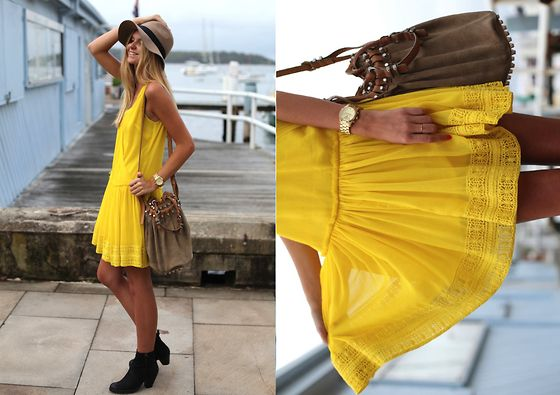 This sunshine yellow drop waist dress is 100% 20s and with it's on trend color 100% 21st Century! Notice she keeps a modern ankle boot and rocker bag and a timeless classic hat!