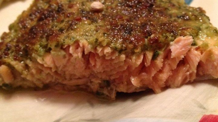 Fresh salmon fillets--or a whole side of salmon--is slathered in pesto ...