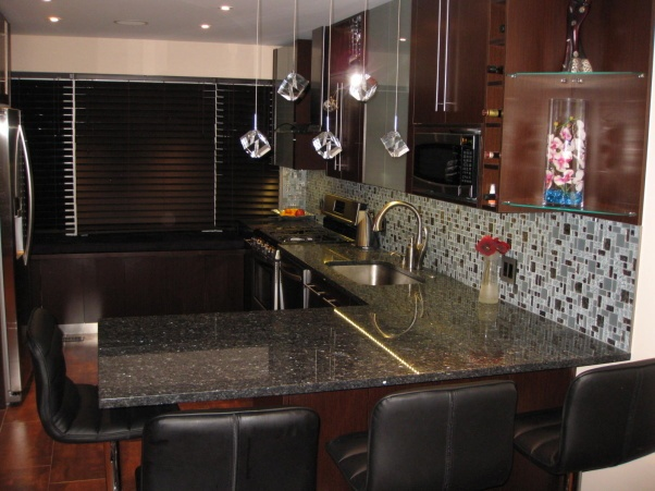 Contemporary Wenge Kitchen With Blue Pearl Granite Counter