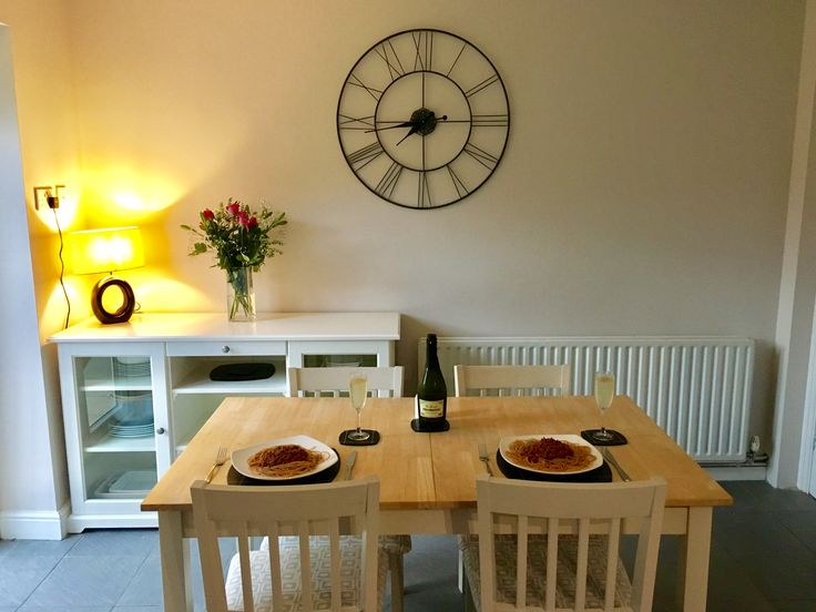 Dining room/kitchen with large clock and Ikea sideboard