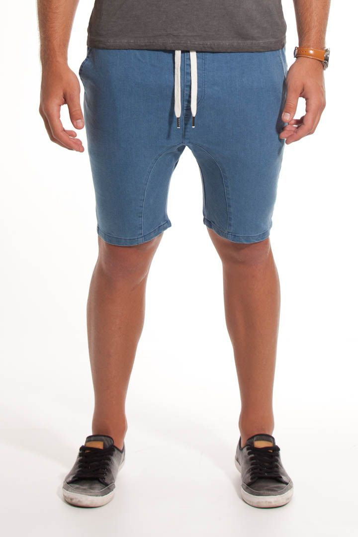 The Boomerang is our signature shorts, designed to be just above the knee with a boomerang resembling curve that cuts across the drop crotch. This slim fit is made from a stretch Denim which in turn works collaboratively with the unique curve for added flex and comfort.