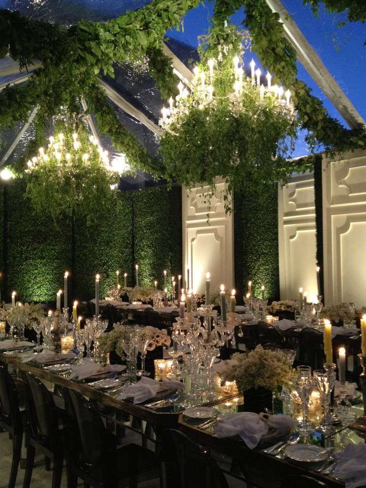 beautiful moss covered room with green garlands and chandeliers with hanging ivy