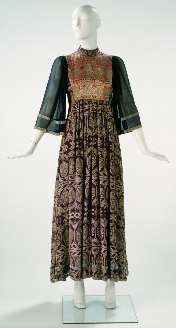 Dress, Thea Porter, 1970s boho ethnic tapestry embroidered long maxi / Blue machine-stitched chiffon with gold and silver thread with a velvet braid Museum no. T.900-2000 © Victoria & Albert Museum, London
