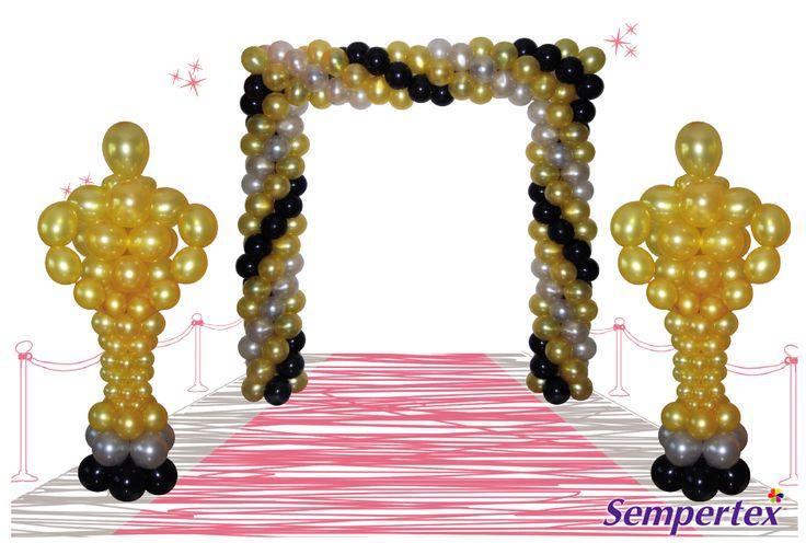 Utiliza un concepto o tema para  determinar la decoración del lugar.  Para la entrada, elabora un arco  cuadrado en espiral con globos  Satín Dorado, Plata y Negro. Coloca  estatuillas hechas en globos R-12, R-9, R-6 Satín dorado para el  cuerpo, disminuyendo tamaño  y  globos  LINK-O-LOON™  para  los  brazos.