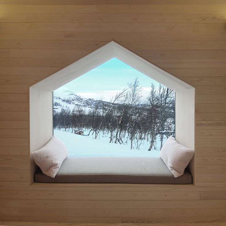 Cozy window seat at Split View Mountain Lodge by Reiulf Ramstad Arkitekter. Photography by Søren Harder Nielsen.