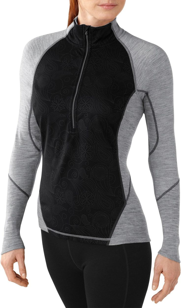 The women's SmartWool PhD NTS Light 195 Wind Zip shirt has a wind-blocking front panel to preserve heat during cross-country ski sessions. #REIGifts
