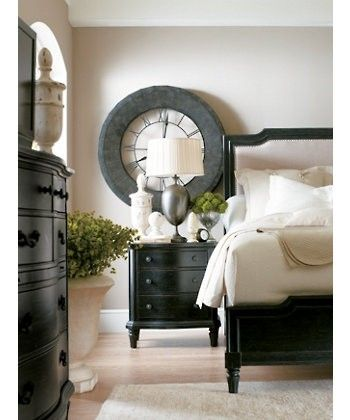 Love the dark furniture with the light walls and linens.