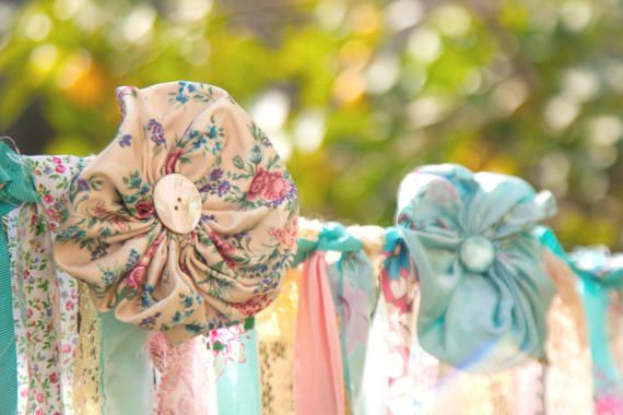 Detail of boho, hippie floral fabric wedding garland in shades of blue and pink. This bohemian banner is perfect for bridal shower, wedding photo backdrop, birthday garland. A tattered garland that you gonna love it.