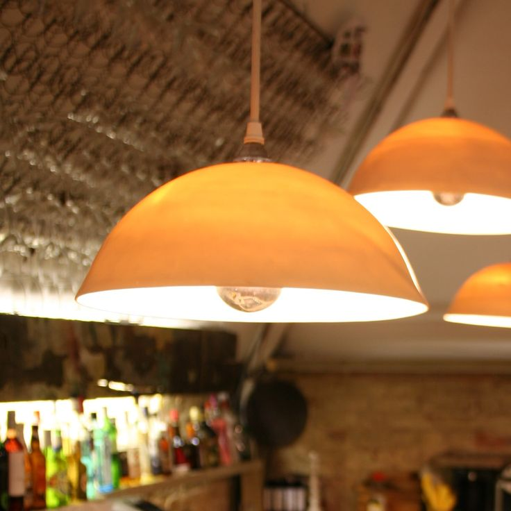 Orange Porcelain Trio Pendant Lights for Kitchen & Bar Decor.  Find more lamp inspiration, DIY tutorials and supplies at www.ilikethatlamp.com