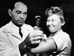 16 August 1957: a nurse at Montefiore Hospital gets the first Asian flu vaccine shot in New York (Image: Associated Press).
