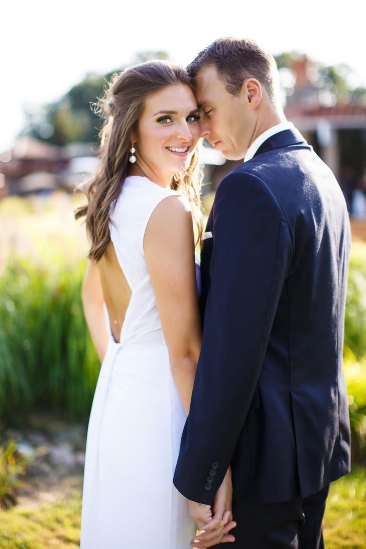 Bride In Dress With Keyhole Back And Groom In Navy Suit