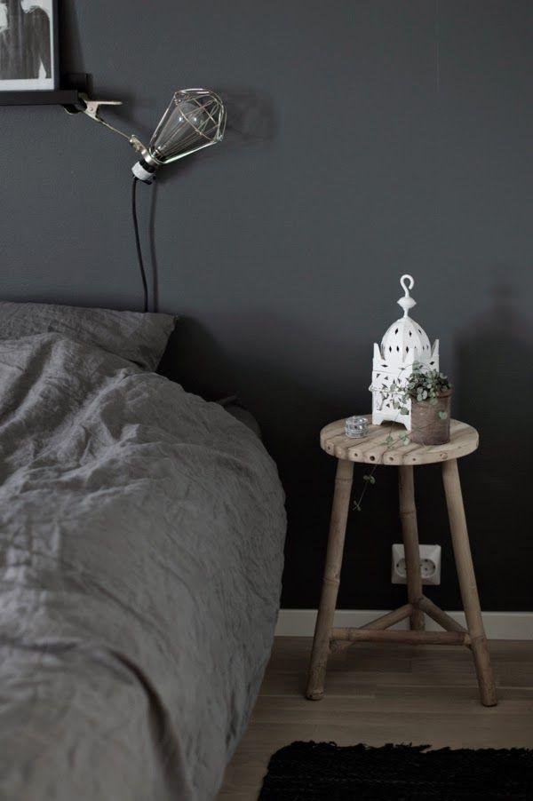 www.thewhitebox.no  Dark gray bedroom. Linen. Frame shelf from IKEA. Lamp from Hay. Bamboo stool. Moroccan lantern.