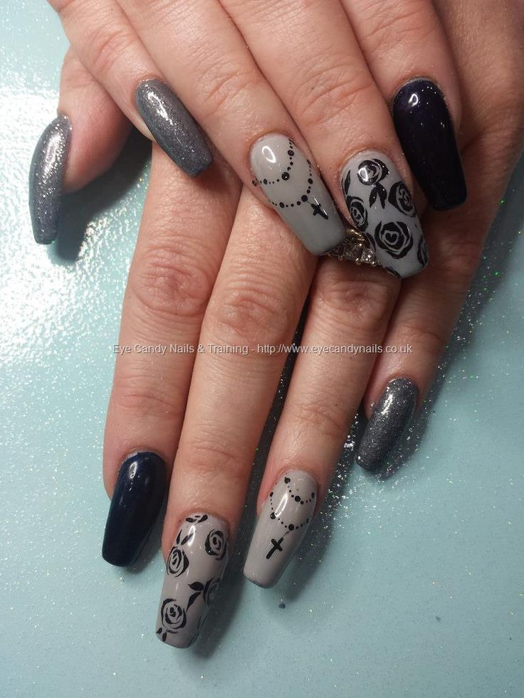 Black and grey gel polish with freehand roses and rosary bead nail art