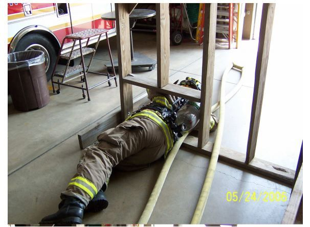 Fire Fighter navigating the SCBA Training Prop