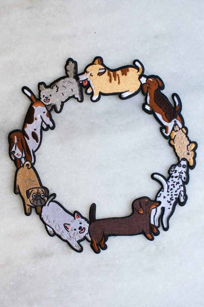 """Embroidered patch with iron-on backing, featuring all your favourite canine pals. This wreath style embroidered patch is 8"""" in diameter and allows you to place"""