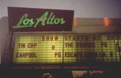 Ah! The Los Altos Drive-In in Long Beach, CA. It expanded to three screens in the 60s. Every kid in town saw a movie here at least once a month. Sadly by the time this photo was taken, it was looking pretty seedy.