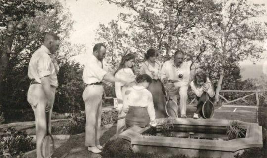 Nicholas,II, Olga, Maria, Tatiana, and Anastasia checking out something in the fountain at Livadia, May, 1914