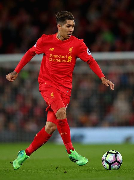 Roberto Firmino of Liverpool in action during the Premier League match between Liverpool and AFC Bournemouth at Anfield on April 5, 2017 in Liverpool, England.
