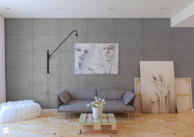 minimalistyczny salon z betonem na ścianie
