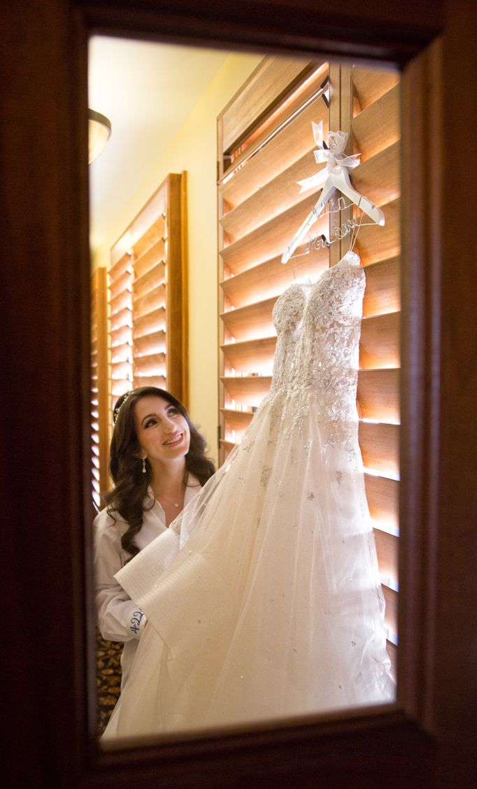 Must-have wedding photo ideas: The bride with her dress! (Jeff Kolodny Photography)
