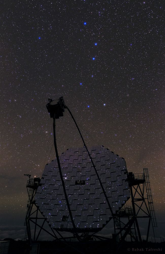 The MAGIC telescope on La Palma detects gamma rays by looking for the characteristic pulses of light given off when they travel faster than (local) light - Cerenkov radiation. Photo by Babak Tafreshi