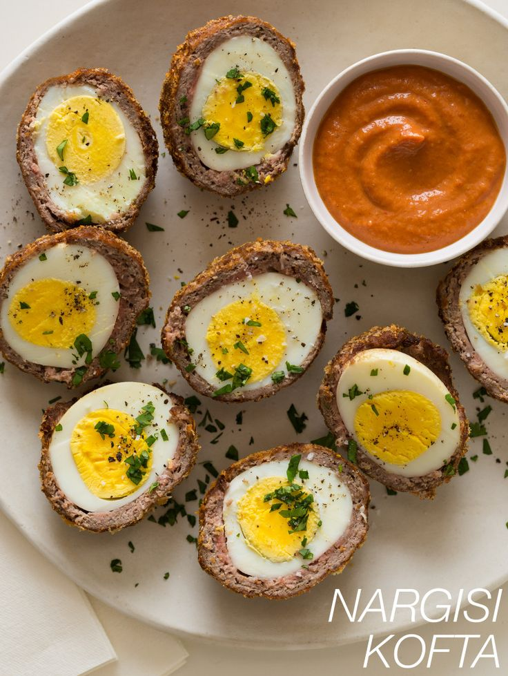 Nargisi Kofta - Think Scotch Eggs with a Twist:  Eggs encased in a flavorful, mouthwatering ground lamb mixture instead of sausage, with a side of delicious masala sauce.