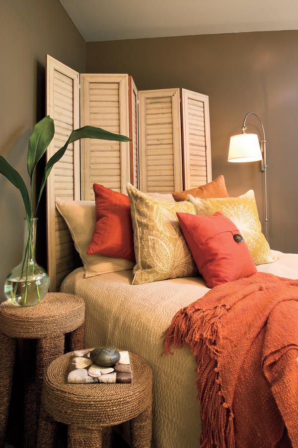Headboard Solution - Fresh Ideas for Fall - Southernliving. A bed never looks finished without a headboard. But what to do if space dictates that you angle your bed into a corner? Try a screen. We had this one made to look like antique shutters and painted to match the bed linens. It's casual, contemporary, and simply neat.