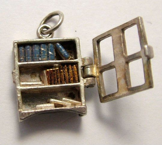 An antique hinged metal bookcase charm. Photo: Sandys Vintage Charms