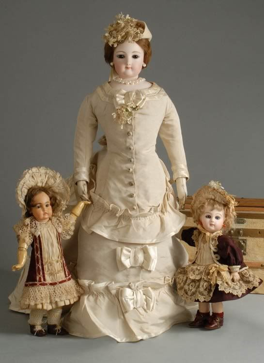 Antique Lady Fashion Doll with two fancy dressed antique small dolls.                                                                                                                                                                                 More