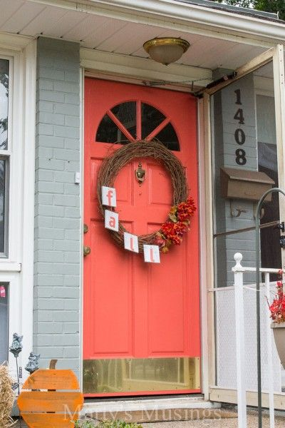Behr Japanese Kimono - beautiful coral front door paint color! What if we painted a wall this color? Maybe in the basement guest room? Almost looks like golden gate bridge color?