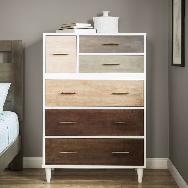 Eclectic and modern, the Christian six-drawer chest features a rich, natural color scheme that complements an impressive variety of home decor styles. Made of sturdy MDF with strong veneers, this rema