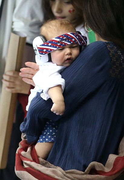 #RIO2016 Michael Phelps' fiancee Nicole Johnson holds their son Boomer Phelps on day 6 of the Rio 2016 Olympic Games at Olympic Aquatics Stadium on August 11...
