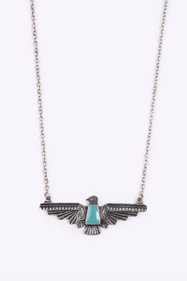 Mini Aztec Eagle Necklace. This links to urban outfitters. I found one at forever 21!!