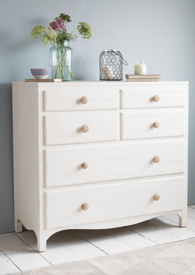 Loaf's simple white chest of drawers with natural wooden handles and heaps of storage space in this coastal bedroom