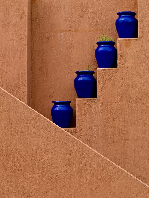 Bright blue against the Saltillo tile colored walls.