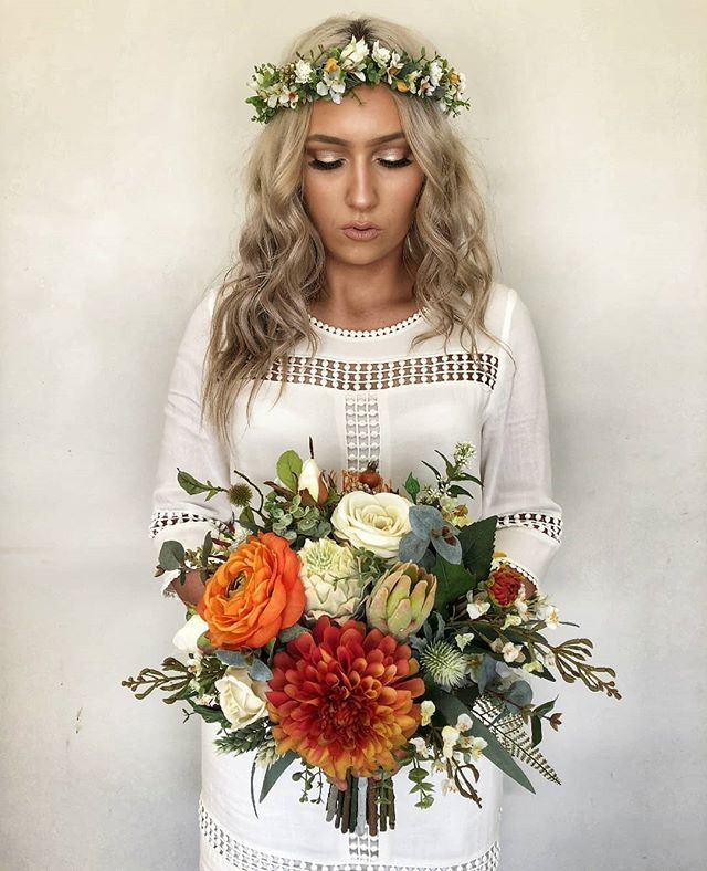 Faux Bouquet and crown autumnal tones and pops of burnt orange. This would look …