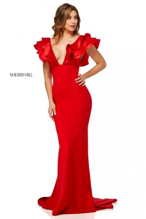 Style 52550 from Sherri Hill is a dramatic ruffle deep V neck fitted prom  gown with ruffles on the open back and sleeves. ce5beda19964