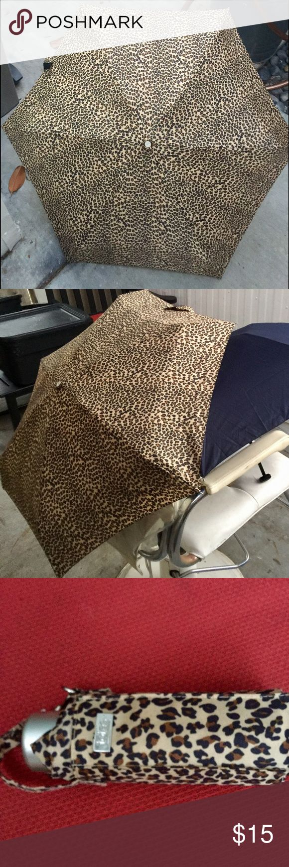 Totes portable animal print umbrella new condition UMBRELLA perfect for this fall weather!!! New condition! Opened but never actually used!!! Leopard animal print. Weight: 8oz Totes Accessories Umbrellas
