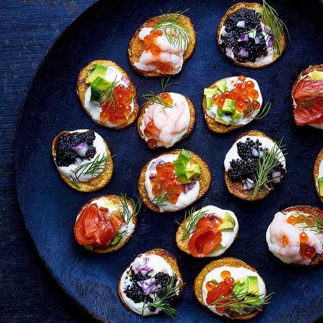 Roasted babypotatoes topped with sourcream, salmon raw, smoked salmon, black caviar, shrimps &…
