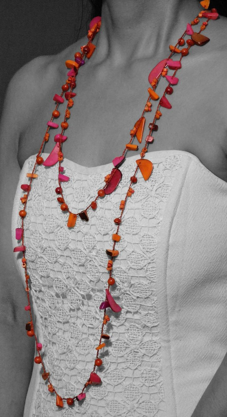 Orange and magenta  Ammandras long necklace projects a luxurious and practical.