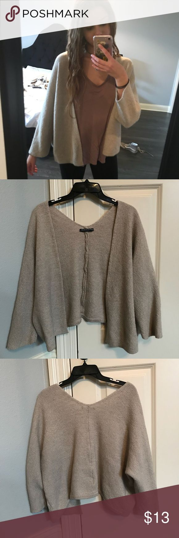 Brandy Melville Cardigan Good condition. Barely worn. Never wear. Wool material. Brandy Melville Sweaters Cardigans