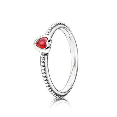 Celebrate all things romantic with this delicate stackable heart ring. Made from sterling silver, the band has a pretty dot effect pattern creating a detailed look. The scarlet red synthetic ruby heart sits prominently in a silver setting, drawing attention to the ring. #PANDORA #PANDORAring