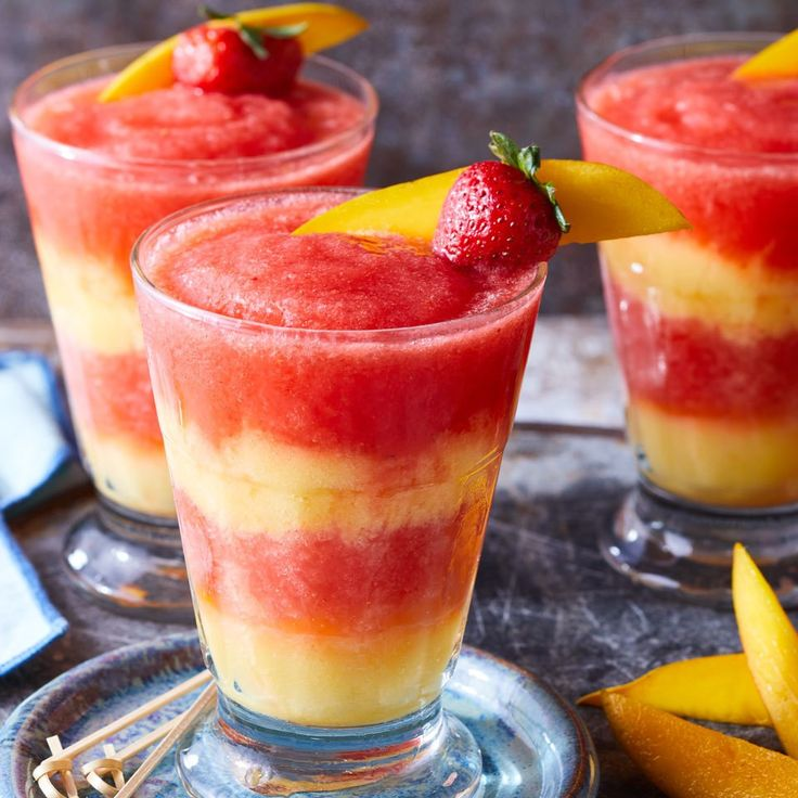 Swirl layers of red strawberry margarita with yellow mango margarita in this skinny frozen cocktail for a festive party drink that will wow your guests. It tastes just as good as a restaurant frozen margarita, without all the sugar!