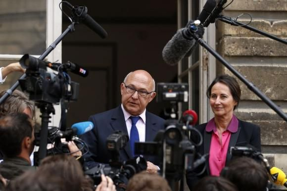 French Ecology, Sustainable Development and Energy Minister Segolene Royal (R) and Finance Minister Michel Sapin speak to the journalists af...