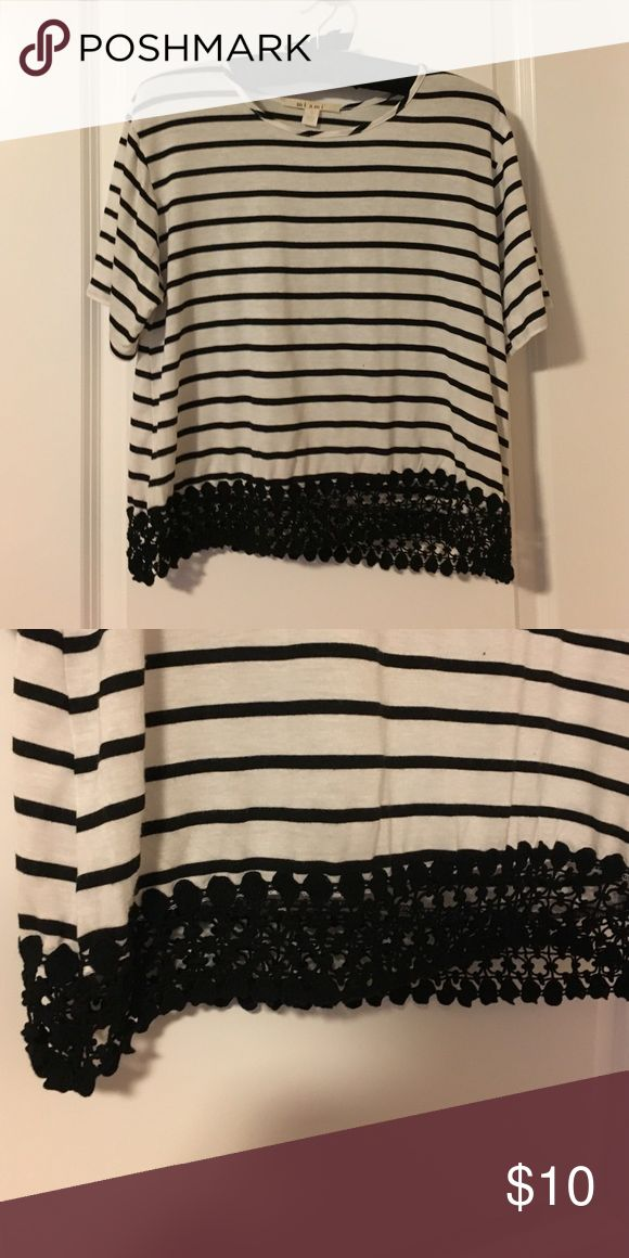 Black and white striped cropped tee Black and white striped tee with a black crochet hemline. Soft cotton tee with a slouchy feel. Tops Crop Tops