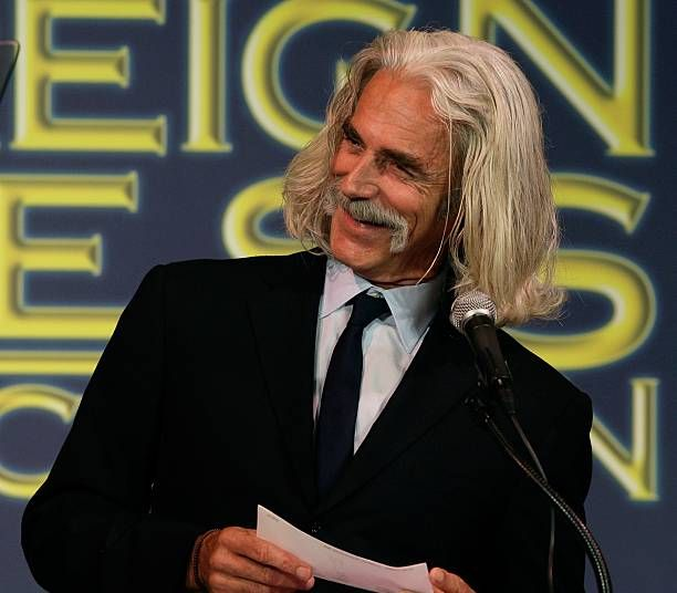 Actor Sam Elliott accepts a check on behalf of the Los Angeles Conservancy onstage during the 2007 HFPA Installation Luncheon held at the Beverly...