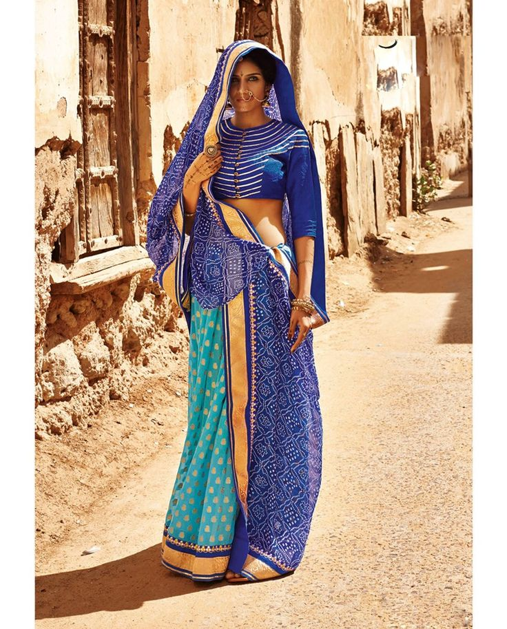 Twin shaded Blue Bandhani Sari 1. Twin shaded blue georgette bandhani sari2. Heavy decorative border3. Comes with matching unstitched blouse